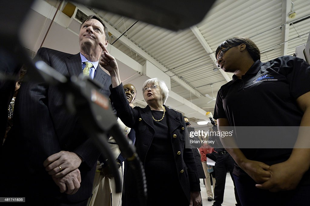 Federal Reserve Chair Janet Yellen (c) and Federal Reserve Bank of Chicago President and CEO Charles Evans (R) are shown a manufacturing machine by student Rasheeda Shannon as they tour the College to Careers Program in Advanced Manufacturing at the City Colleges of Chicago's Daley College on March 31, 2014 in Chicago, Illinois. In earlier remarks Yellen indicated that the economy was far from healthy and that the Fed would continue its policy of maintaining low interest rates.