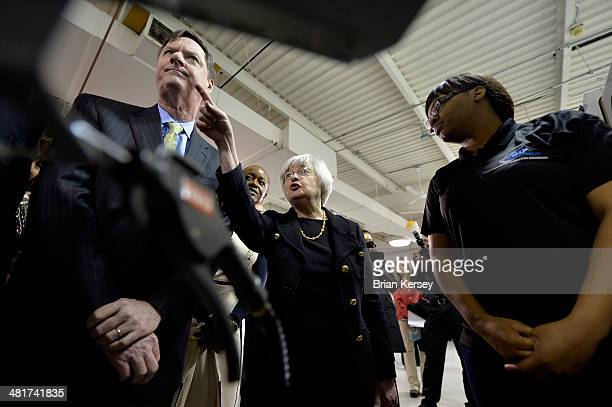 Federal Reserve Chair Janet Yellen and Federal Reserve Bank of Chicago President and CEO Charles Evans are shown a manufacturing machine by student...