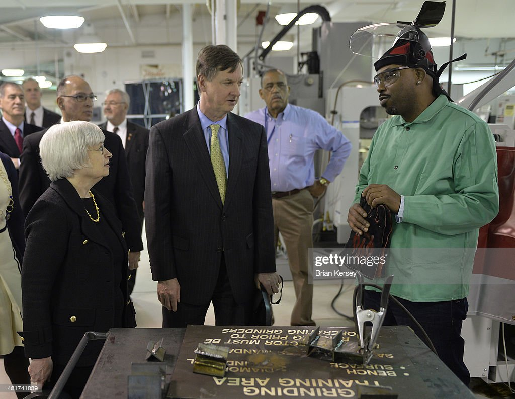 Federal Reserve Chair Janet Yellen (L-R) and Federal Reserve Bank of Chicago Chairman and CEO Charles Evans talk with student Shaylo Davis as they tour the College to Careers Program in Advanced Manufacturing at the City Colleges of Chicago's Daley College on March 31, 2014 in Chicago, Illinois. In earlier remarks Yellen indicated that the economy was far from healthy and that the Fed would continue its policy of maintaining low interest rates.