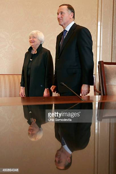 S Federal Reserve Chair Janet Yellen and New Zealand Prime Minister John Key arrive for a photo opportunity at the Fed headquarters June 19 2014 in...