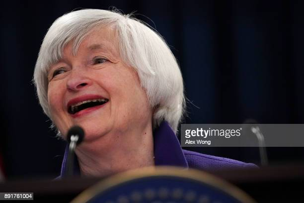 Federal Reserve Chair Janet Yellen laughes during a news conference December 13 2017 in Washington DC Yellen announced that the Federal Reserve is...