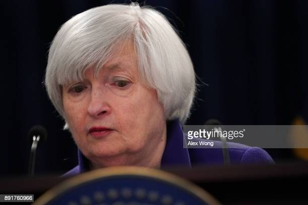 Federal Reserve Chair Janet Yellen pauses during a news conference December 13 2017 in Washington DC Yellen announced that the Federal Reserve is...