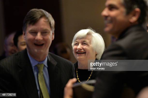 Federal Reserve Chair Janet Yellen smiles as she is introduced as the keynote speaker at the 2014 National Interagency Community Reinvestment...
