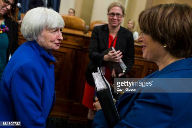 Federal Reserve Chair Janet Yellen speaks to Senator Amy Klobuchar as she departs after testifying during a Joint Economic Committee on Economy...