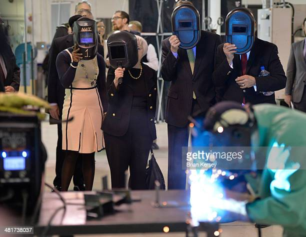 Federal Reserve Chair Janet Yellen watches a welding demonstration as she tours the College to Careers Program in Advanced Manufacturing at the City...
