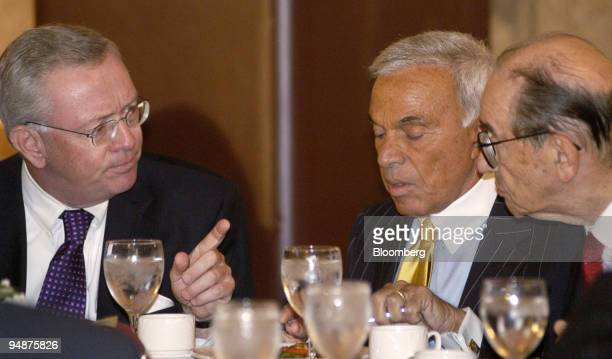 Federal Reserve Chairman Alan Greenspan right talks with Richard Syron CEO of Freddie Mac left during a luncheon with the National Italian American...
