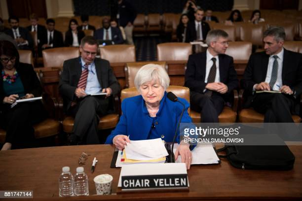Federal Reserve Chairman Janet Yellen looks at her papers before a hearing of the Joint Economic Committee on Capitol Hill November 29 in Washington...