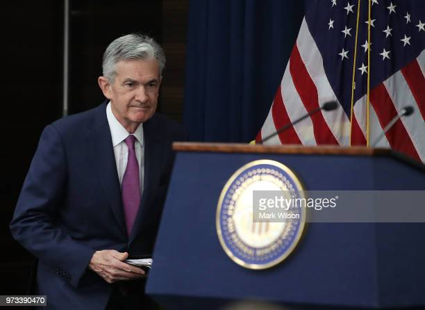 S Federal Reserve Chairman Jerome Powell walks into a news conference June 13 2018 in Washington DC After a twoday meeting the Chairman Powell...