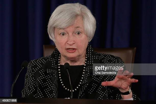 Federal Reserve Chairwoman Janet Yellen speaks during a news conference at Fed headquarters June 18 2014 in Washington DC The central bank issued its...