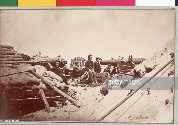 Federal sailors lounge around two 80pounder Whitworth rifles during the siege of Fort Sumter The naval deck carriage of the rifle at the right...