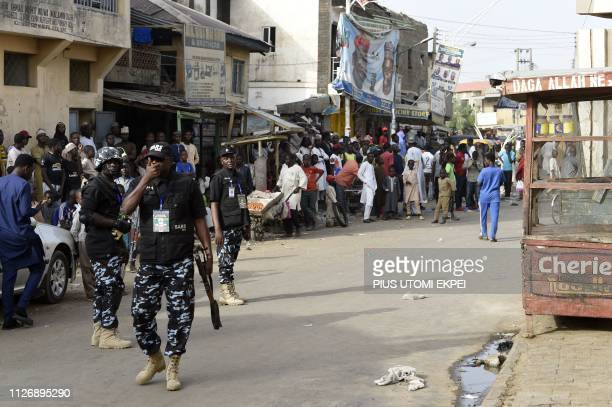 Federal Special AntiRobbery Squad check disturbances by hoodlums at a polling station in Kano commercial capital of northern Nigeria on February 23...