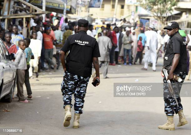 Federal Special AntiRobbery Squad check disturbances by hoodlums at a polling station in Kano the commercial capital of northern Nigeria on February...