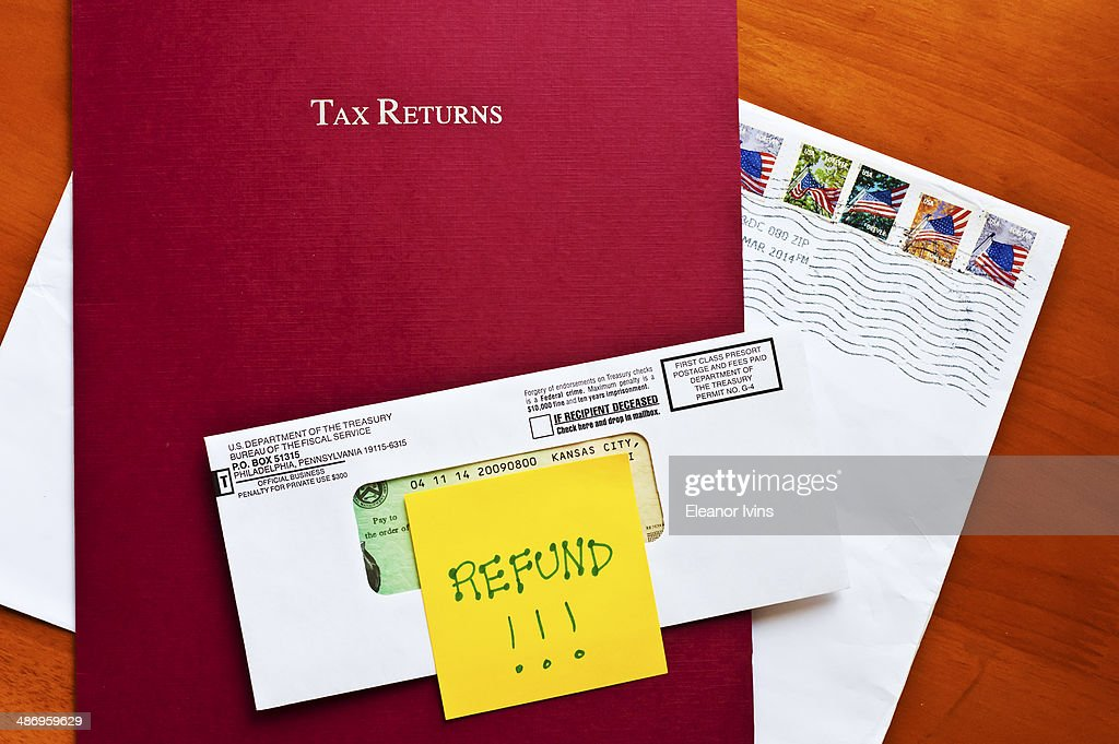 Us tax day pictures getty images federal tax refund with tax folder and stamped envelope sciox Image collections