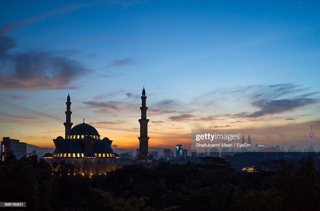 Federal Territory Mosque Against Cloudy Sky At Dusk : Stock Photo