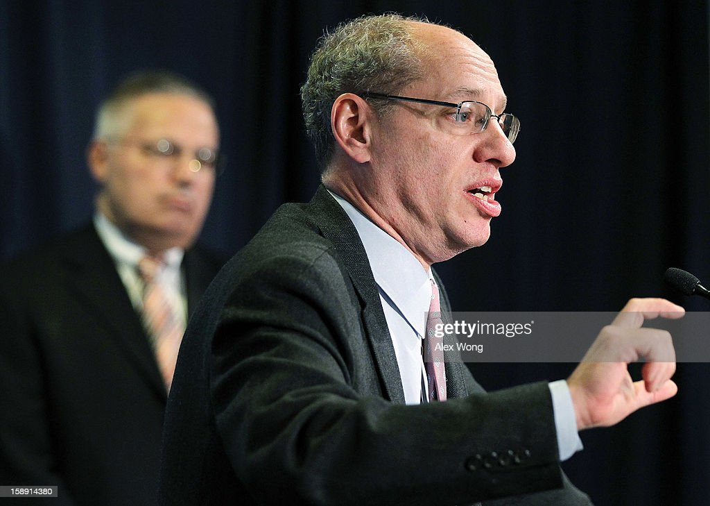 U.S. Federal Trade Commission Chairman Jon Leibowitz (R) speaks as Acting Director of the Bureau of Consumer Protection Charles Harwood listens during a news conference regarding the agency's 21-month-long investigation on Google January 3, 2013 at the FTC headquarters in Washington, DC. FTC announced that Google has agreed to change some of its business practices, including giving competitors access to standard-essential patents and letting advertisers to get more flexibility to use rival search engines, to resolve the agency's competition concerns in the markets for devices like smart phones, games and tablets and in online searching.