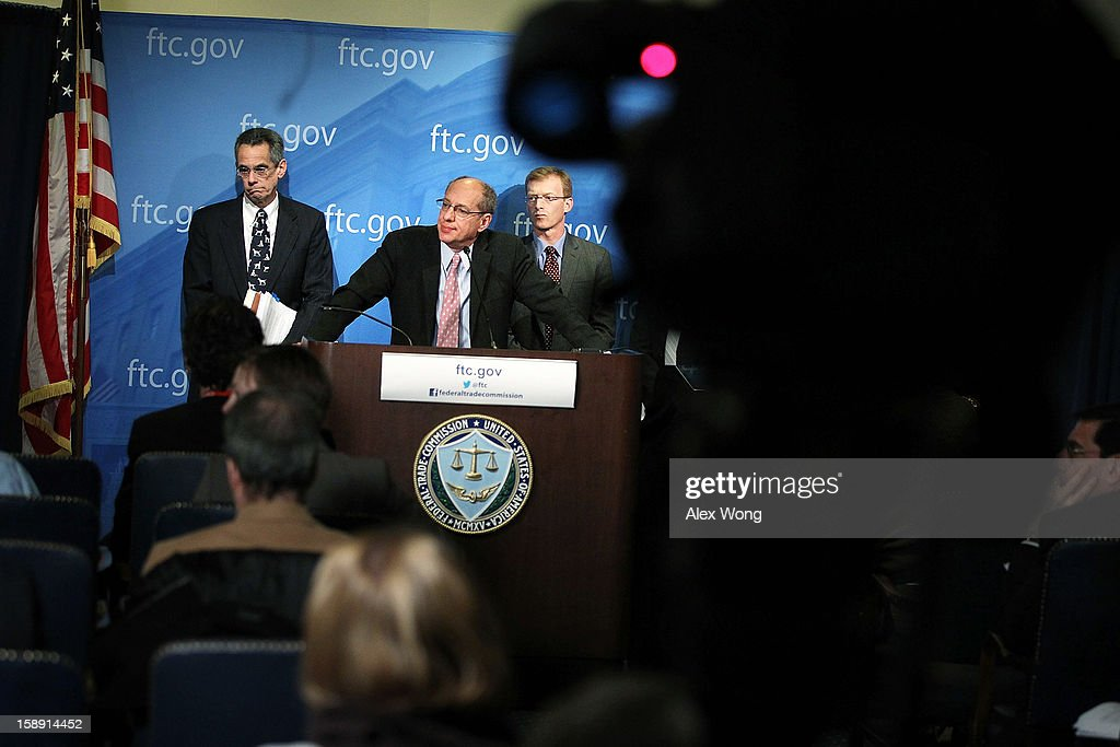 U.S. Federal Trade Commission Chairman Jon Leibowitz (2nd L) speaks as Bureau of Competition Director Richard Feinstein (L), and Bureau of Economics Director Howard Shelanski (R) listen during a news conference regarding the agency's 21-month-long investigation on Google January 3, 2013 at the FTC headquarters in Washington, DC. FTC announced that Google has agreed to change some of its business practices, including giving competitors access to standard-essential patents and letting advertisers to get more flexibility to use rival search engines, to resolve the agency's competition concerns in the markets for devices like smart phones, games and tablets and in online searching.