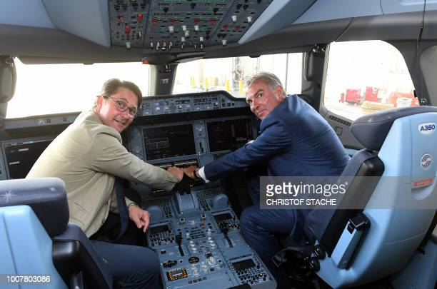 Federal Transport Minister Andreas Scheuer and the CEO of the CEO of German airline Lufthansa Carsten Spohr pose in the cockpit of the tenth...