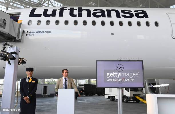 Federal Transport Minister Andreas Scheuer gives a speech during a naming ceremony of the tenth Lufthansa Airbus A350900 on July 30 2018 at the...