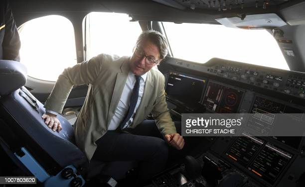 Federal Transport Minister Andreas Scheuer poses in the cockpit of the tenth Lufthansa Airbus A350900 during a naming ceremony of the aircraft on...
