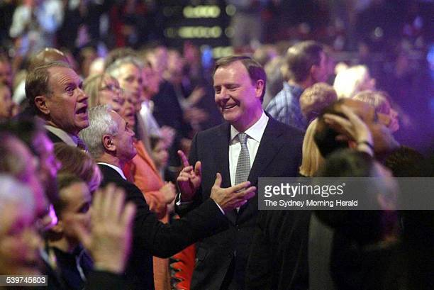Federal Treasurer Peter Costello right delivers an address at the opening ceremony for the annual Hillsong convention as Bruce Baird left looks on at...