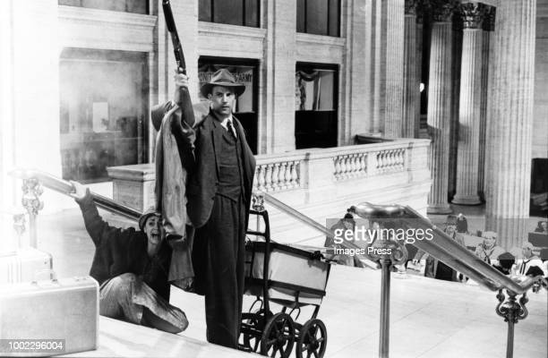 LOS ANGELES CIRCA 1987 Federal Treasury Agent Eliot Ness battles Al Caone's mob on the steps of Union Station in Prohibition Chicago Paramount...