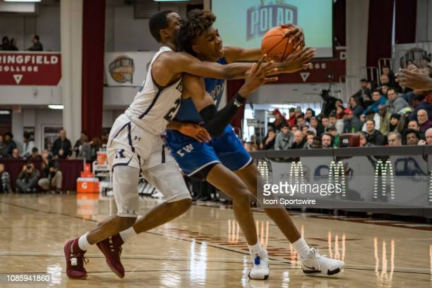 Federal Way Eagles forward Jaden McDaniels battles with Ranney Panthers guard Scottie Lewis during the first half of the high school basketball game...