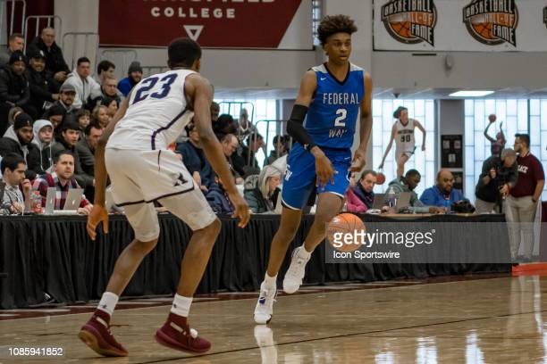 Federal Way Eagles forward Jaden McDaniels brings the ball up court during the first half of the high school basketball game between the Ranney...
