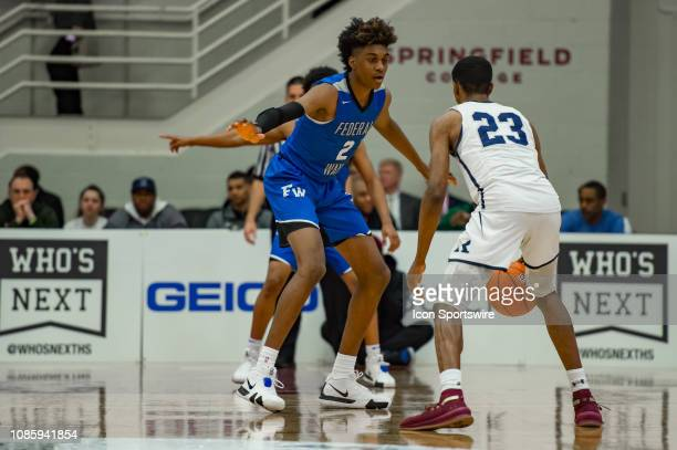 Federal Way Eagles forward Jaden McDaniels defends Ranney Panthers guard Scottie Lewis during the first half of the high school basketball game...