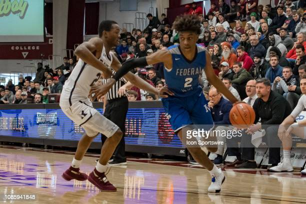 Federal Way Eagles forward Jaden McDaniels drives to the basket during the first half of the high school basketball game between the Ranney Panthers...