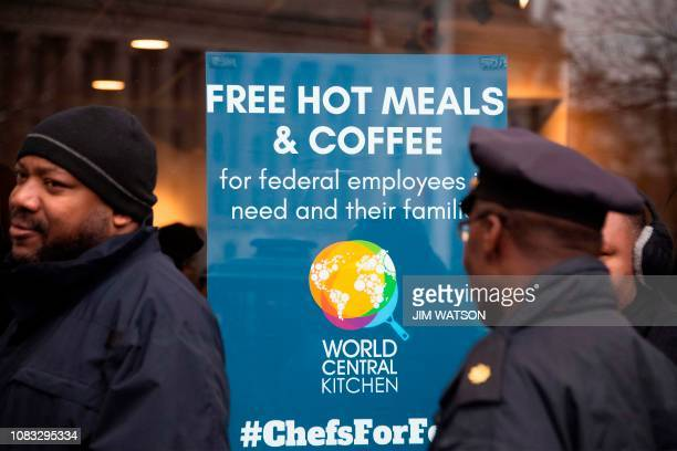 Federal workers stand in line for a free hot meal at Andres in Washington DC on January 16 as the restaurant reached out to locals providing...