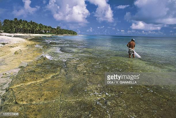 Federated States of Micronesia Yap Islands Ulithi Atoll Fala Lop Island fisherman on the beach
