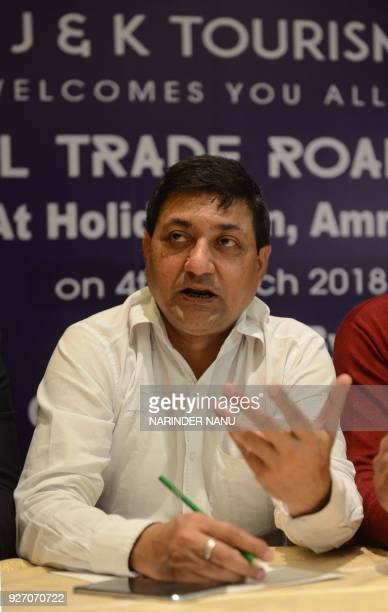 Federation of Registered Travel Associations of Jammu Chairman Rajesh Chandan speaks during a press conference to promote Jammu and Kashmir Tourism...