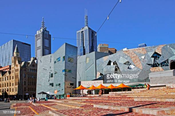 federation square and skyline , melbourne. - federation square stock pictures, royalty-free photos & images