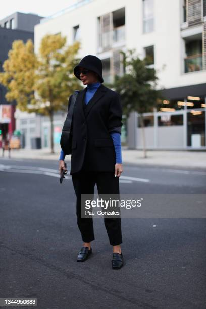 Federica Labanca is seen wearing a Black Suit at COS during London Fashion Week September 2021 on September 21, 2021 in London, England.