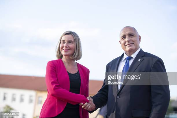 Federica Mogherini foreign policy chief of the European Union left is greeted by Boyko Borissov Bulgaria's prime minister as she arrives for an...