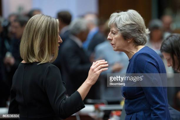 Federica Mogherini foreign policy chief of the European Union left speaks with Theresa May UK prime minister ahead of roundtable talks with European...