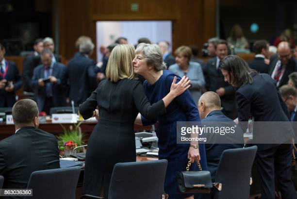 Federica Mogherini foreign policy chief of the European Union left greets Theresa May UK prime minister ahead of roundtable talks with European Union...