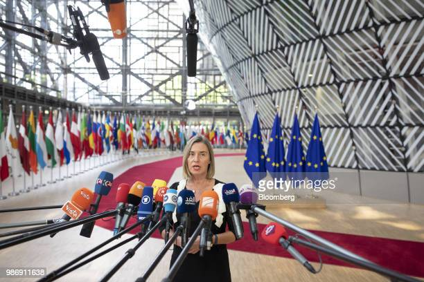 Federica Mogherini foreign policy chief of the European Union speaks to the media as she arrives for a European Union leaders summit in Brussels...