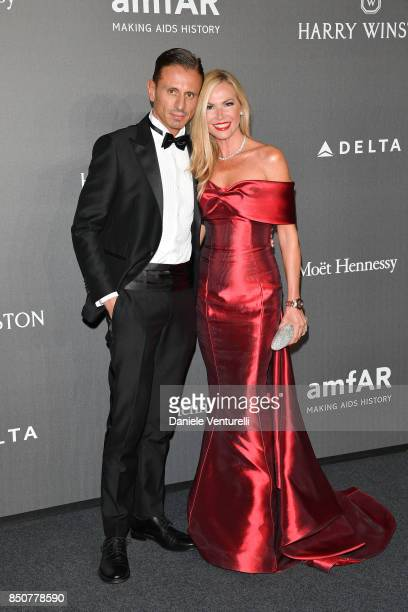 Federica Panicucci and Marco Bacini walk the red carpet of amfAR Gala Milano on September 21 2017 in Milan Italy