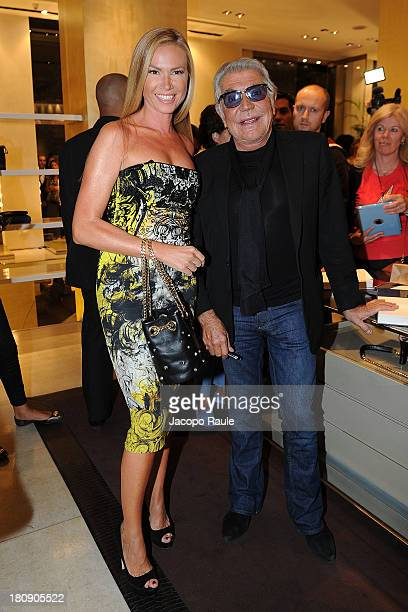 Federica Panicucci and Roberto Cavalli attend Roberto Cavalli Cocktail during Milan Vogue Fashion Night Out at on September 17 2013 in Milan Italy