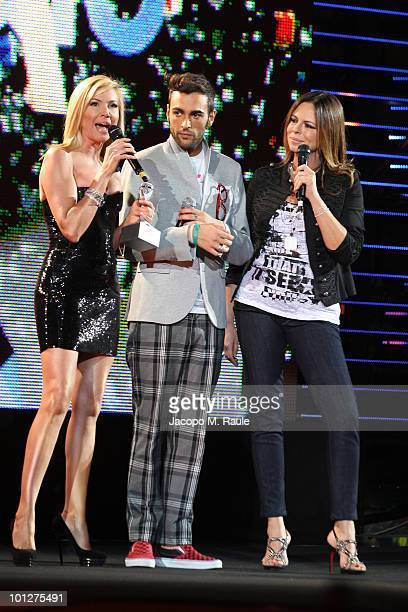 Federica Panicucci, Marco Mengoni, Paola Perego attend the 2010 Wind Music Awards on May 29, 2010 in Verona, Italy.
