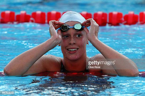 Federica Pellegrini of Italy celebrates after breaking the world record, setting a new time of 3:59.15 seconds in the Women's 400m Freestyle Final...