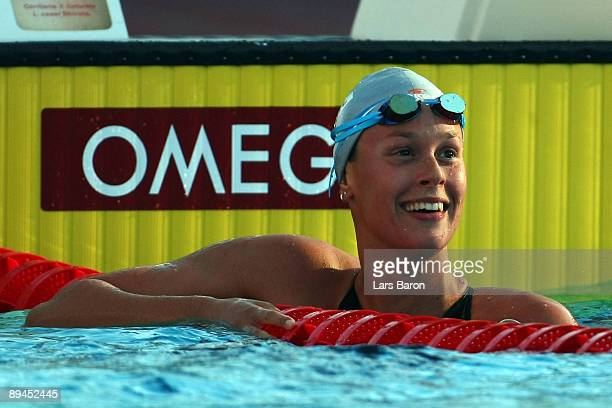 Federica Pellegrini of Italy celebrates after breaking the world record setting a new time of 1:52.98 seconds in the Women's 200m Freestyle Final...