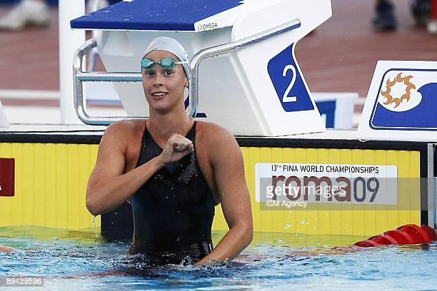 Federica Pellegrini of Italy celebrates after winning the women's 200m Freestyle semifinal in a world record ime during the 13th FINA World...