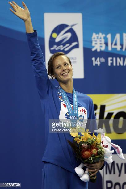 Federica Pellegrini of Italy celebrates winning the gold medal in the Women's 400m Freestyle Final during Day Nine of the 14th FINA World...