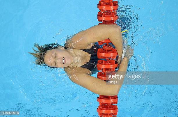 Federica Pellegrini of Italy dunks her head back into the water after she won the gold medal in the Women's 200m Freestyle Final during Day Twelve of...