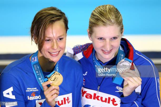 Federica Pellegrini of Italy poses with the gold medal and silver medalist Rebecca Adlington of Great Britain after the Women's 400m Freestyle Final...