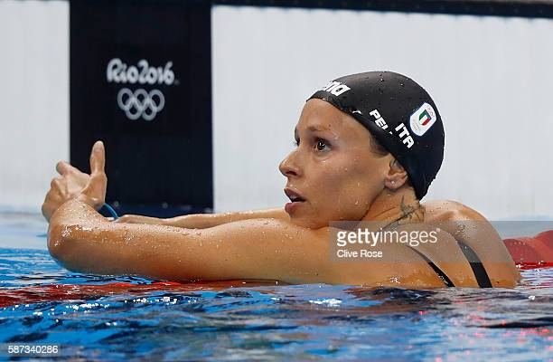 Federica Pellegrini of Italy reacts in the Women's 200m Freestyle heat on Day 3 of the Rio 2016 Olympic Games at the Olympic Aquatics Stadium on...