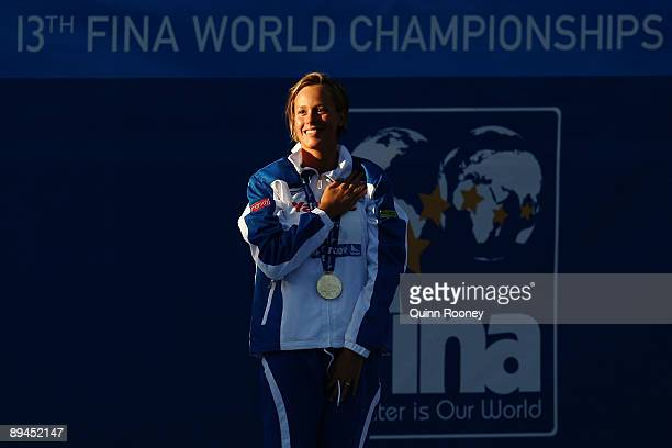 Federica Pellegrini of Italy receives the gold medal during the medal ceremony for the Women's 200m Freestyle Final during the 13th FINA World...