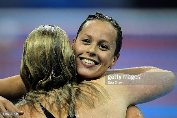 Federica Pellegrini of Italy smiles after winning the gold medal with silver medalist Rebecca Adlington of Great Britain after the Women's 400m...